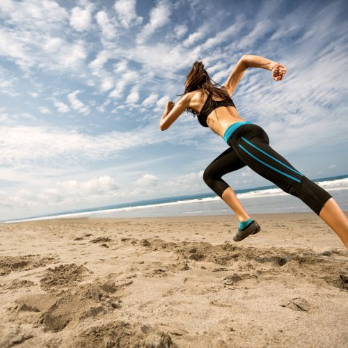 Woman running on the beach, fitness and health care concept